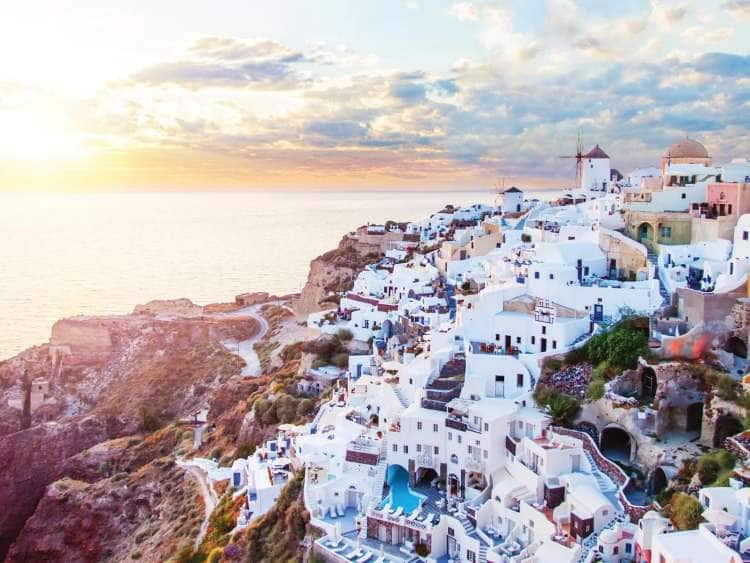 Sunrise aerial view of Santorini, Greece which can be seen on a Seabourn Luxury cruise to Greece Islands on the Aegean Sea