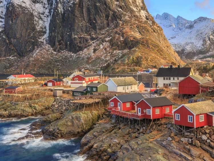 Hamnoy fishing village with red rorbu houses in Norwegian fjord in winter. Lofoten Islands, Norway. Seabourn Northern Europe Experience