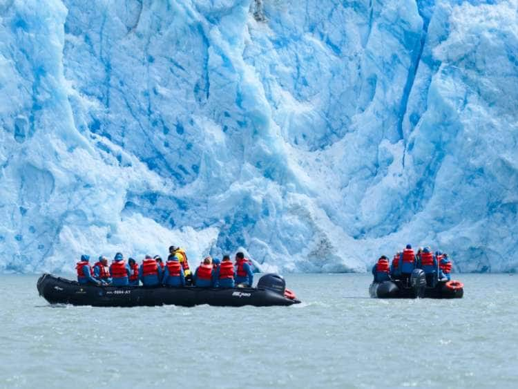 Rafters viewing a glacier on an all-inclusive Alaska cruise
