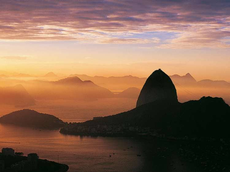 Sunrise aerial view of Rio De Janeiro, Brazil which can be seen on a Seabourn Luxury cruise to South America