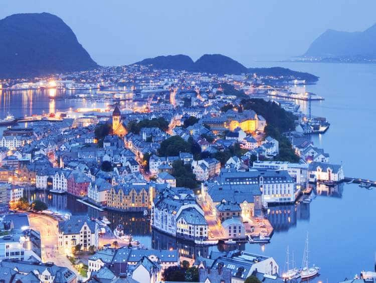 Norway, More og Romsdal, Alesund, Scandinavia, View from Aksla mountain towards old town and harbor illuminated at dusk