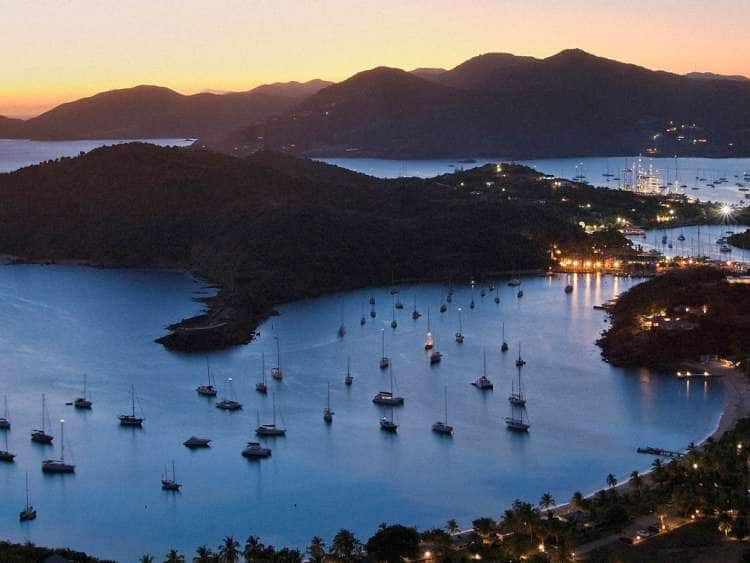 Caribbean, Antigua and Barbuda, Antigua, Shirley Heights, panoramic view towards English Harbor and Falmouth Harbor at dusk