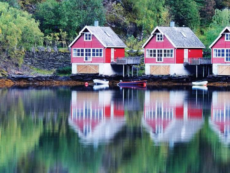 Scenic View of lake and fishing huts in Flam, Norway.