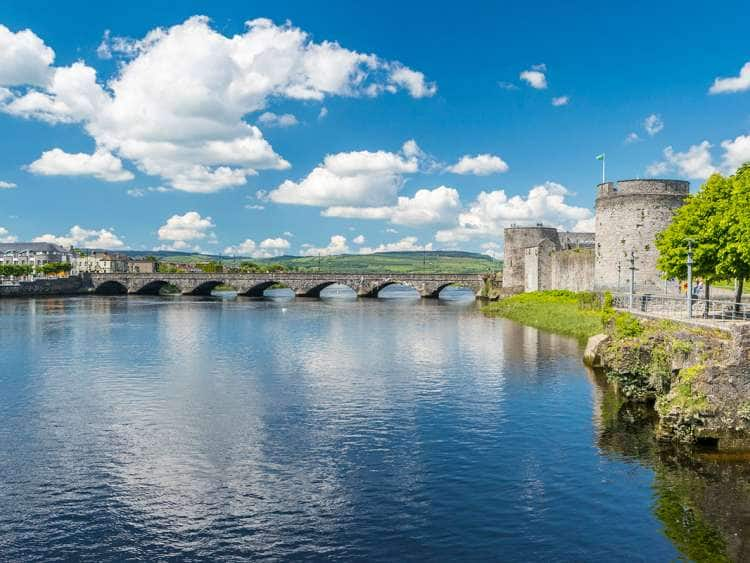 Ireland, Limerick, Thomondgate, King John's Castle and the River Shannon with Thomond Bridge