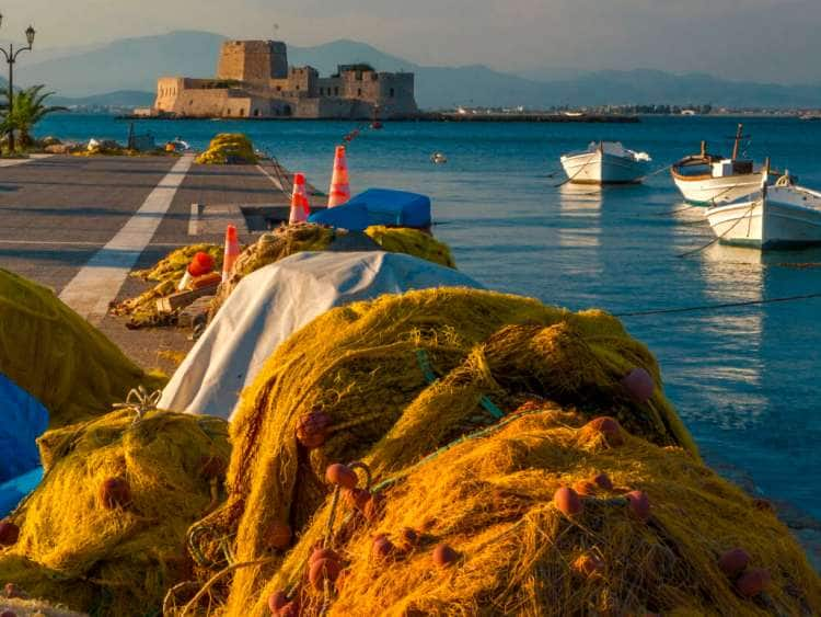 Greece, Peloponnese, Argolis, Mediterranean sea, Aegean sea, Nafplio, Nauplia, Harbor Mole, Bourtzi castle, Castel da Mar, sunset