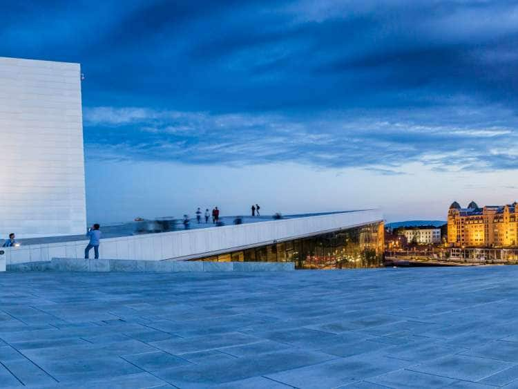 Norway, Oslo county, Oslo, Scandinavia, Oslo Opera House, The Oslo Opera House (Operahuset), Snohetta architects, the town on the background