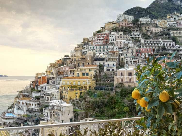 Italy, Campania, Salerno district, Amalfi Coast, Mediterranean sea, Tyrrhenian sea, Tyrrhenian coast, Peninsula of Sorrento, Positano, Lemon tree on a terrace with Positano in the background
