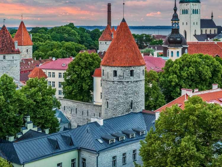 View from the Observation Terrace on Cathedral Hill across the Old Town with City Fortifications and St. Olaf's Church in the Evening, Tallinn, Estonia