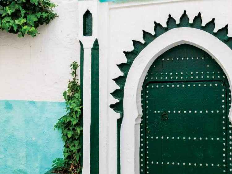 DYB3A6 Green wooden gate of ancient mosque in Medina. Tangier, Morocco