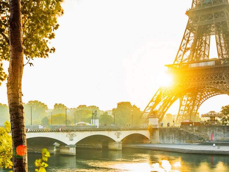 France, Paris, The Eiffel Tower at sunrise and Seine river