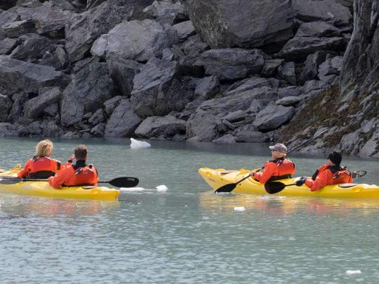 A picture of guests kayaking down a river while on one of many Seabourn expeditions in Alaska
