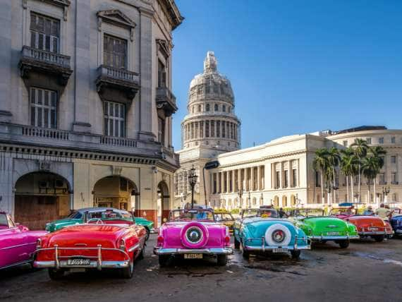 Cuba, Havana Province, Havana, Classic Car with National Capitol Building on Paseo de Marti in Havana