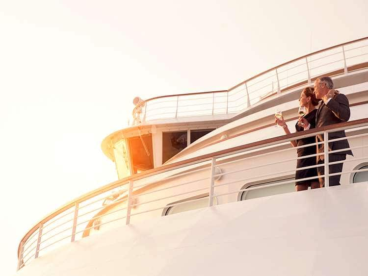 A couple on the deck of an ultra-luxury Seabourn cruise