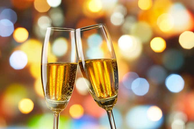 @ tall flutes of champagne flutes toasting -- Ultra-Luxury Cruises Seabourn
