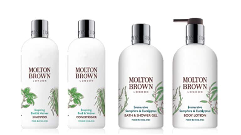 A photo of Molton Brown body products line designed for Seabourn. White bottles wtih images of plants and sliver bottle lids, in brown print labeling Molton Brown: Shampoo, Conditioner, Bath and Shower Gel and Body Lotion.