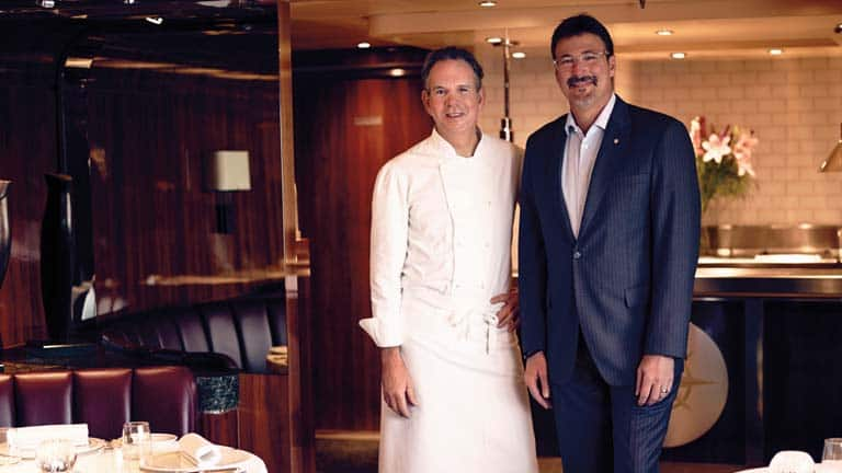A photo of Thomas Keller and Richard D. Meadows smiling side by side in a Seabourn restaurant.