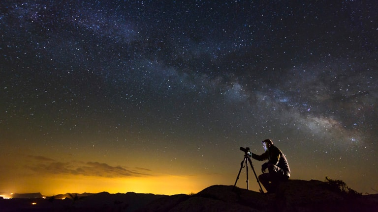 Man looking at stars through a telescope -- Seabourn Science Conversations